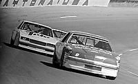 Bill Elliott, #9 Harry Melling Coors Ford , Darrell Waltrip, #17 Rick Hendrick Tide Chevrolet, action, tuen 4, Daytona 500, Daytona International Speedway, Daytona Beach, Florida, February 15, 1987. (Photo by Brian Cleary/www.bcpix.com)