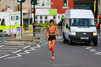 3rd October 2021; London, England: The Virgin Money 2021 London Marathon: Dylan Hassett of Ireland running on Butcher Row, Limehouse between mile 21 and 22 starting towards central London and the finish.