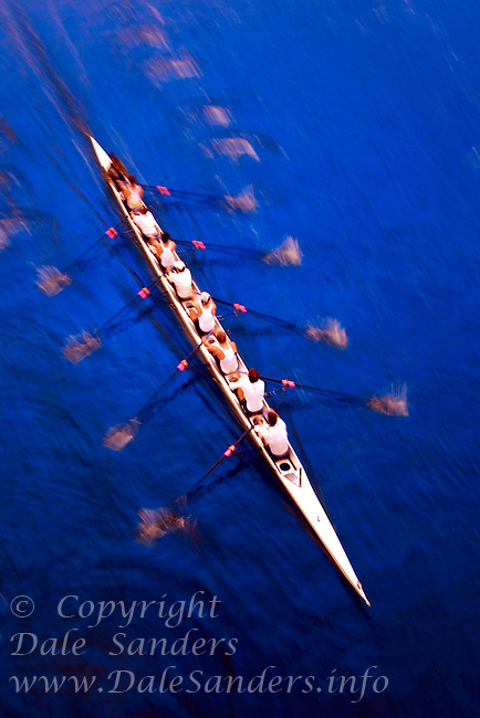 Overhead view of Rowing on blue water,  Racing an eight.  Motion Blurred