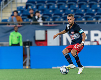 FOXBOROUGH, MA - JULY 9: Jake Rozhansky #32 of New England Revolution II dribbles during a game between Toronto FC II and New England Revolution II at Gillette Stadium on July 9, 2021 in Foxborough, Massachusetts.
