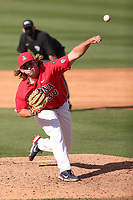 Riley Cooper (38) of the Arizona Wildcats pitches against the UCLA Bruins at Jackie Robinson Stadium on March 20, 2021 in Los Angeles, California. Arizona defeated UCLA, 7-3. (Larry Goren/Four Seam Images)