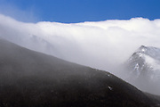 Tuckerman Ravine, on the eastern slope of Mount Washington, in the New Hampshire White Mountains during an extremely windy winter day. Lion Head is on the right.