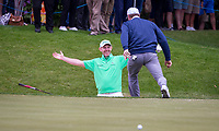Paul Casey (England) celebrates with Brian McFadden (Singer / Songwriter) after his shot from the bunker goes in during the BMW PGA PRO-AM GOLF at Wentworth Drive, Virginia Water, England on 23 May 2018. Photo by Andy Rowland.