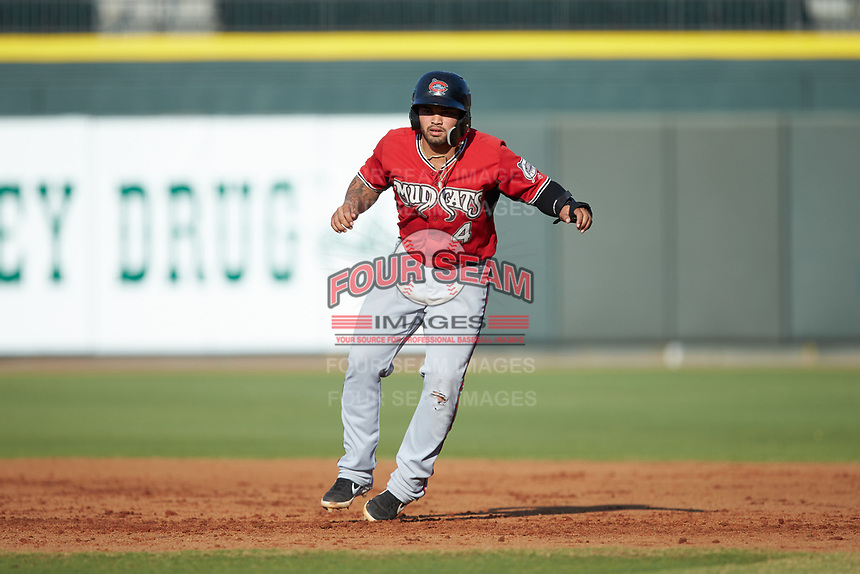 Mario Feliciano (4) of the Carolina Mudcats takes his lead off of first base against the Winston-Salem Dash at BB&T Ballpark on June 1, 2019 in Winston-Salem, North Carolina. The Mudcats defeated the Dash 6-3 in game one of a double header. (Brian Westerholt/Four Seam Images)