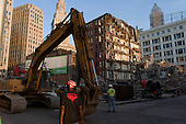 Cleveland, Ohio.July 22, 2011..Demolition of a century-old Columbia Building, a city landmark to make way for a casino parking lot. Casino developers argued that without the parking operation, there would be no casino...Rock Gaming LLC is building a $400 million casino with Caesars Entertainment Corp...The plan clashed with preservationists who argued that the building, known as the largest reinforced concrete building in Ohio when it was built in 1909, should be saved...Designed by architect M.E. Wells. It has been the home to many different businesses over the years. The most recent tenant was David N. Myers University, who occupied the space from 1985 until a recent move.