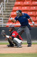 Home plate umpire Doug Vines makes a strike call at L.P. Frans Stadium June 21, 2009 in Hickory, North Carolina. (Photo by Brian Westerholt / Four Seam Images)
