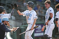 Har-Ber High School's Ross Felder is congratulated after scoring the first run of the game  Monday, April 26, 2021, against Rogers High School at Arvest Ballpark in Springdale. Check out nwaonline.com/210427Daily/ and nwadg.com/photos for a photo gallery.<br /> (NWA Democrat-Gazette/David Gottschalk)