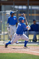 Toronto Blue Jays second baseman Mattingly Romanin (8) follows through on a swing during a minor league Spring Training game against the New York Yankees on March 30, 2017 at the Englebert Complex in Dunedin, Florida.  (Mike Janes/Four Seam Images)