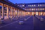 The night view of Colonnes de Buren aka Les Deux Plateaux by artist Daniel Buren in courtyard of Palais Royal. Paris. city of Paris. France