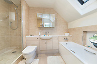 BNPS.co.uk (01202) 558833. <br /> Pic: SandersonYoung/BNPS<br /> <br /> Bathroom.<br /> <br /> A quirky 'show home' for a brickwork owner where Lewis Carroll is believed to have stayed while writing some of his Alice in Wonderland books is on the market for just under £1m.<br /> <br /> Red Cottage is a striking Grade II listed property in Whitburn, Tyne and Wear, where Charles Dodgson, otherwise known as Lewis Carroll, regularly visited family.<br /> <br /> The unusual 179-year-old home was built to show off as many design features as possible, and has a walled garden and even an air raid shelter.