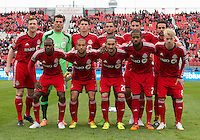 Toronto, Ontario - April 12, 2014: The starting eleven for the Toronto FC in a game between the Colorado Rapids and Toronto FC at BMO Field in Toronto.<br />