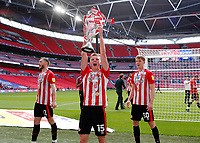 29th May 2021; Wembley Stadium, London, England; English Football League Championship Football, Playoff Final, Brentford FC versus Swansea City; Marcus Forss of Brentford celebrates with the Sky Bet EFL Championship Plays-off Trophy and their 2-0 win and promotion to the Premier League