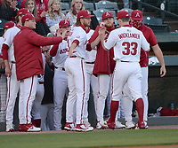 Arkansas starter Patrick Wicklander is congratulated by teammates Thursday, April 1, 2021, as he returns to the dugout after the third out of the top of the first inning of play against Auburn at Baum-Walker Stadium in Fayetteville. Visit nwaonline.com/210402Daily/ for today's photo gallery. <br /> (NWA Democrat-Gazette/Andy Shupe)