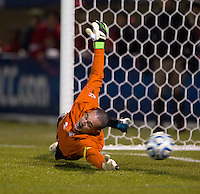 Scott Goodwin (1) of North Carolina extends himself as the ball slides wide of the net on a penalty kick during the game at the Maryland SoccerPlex in Germantown, MD. North Carolina defeated Virginia on penalty kicks after playing to a 0-0 tie in regulation time.  With the win the Tarheels advanced to the finals of the ACC men's soccer tournament.