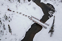 Allen Moore crosses a bridge over Solomon Creek between Rohn and Nikolai during the 2018 Iditarod race on Tuesday afternoon March 06, 2018. <br /> <br /> Photo by Jeff Schultz/SchultzPhoto.com  (C) 2018  ALL RIGHTS RESERVED