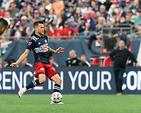 FOXBOROUGH, MA - JULY 25: Arnor Traustason #25 of New England Revolution passes the ball during a game between CF Montreal and New England Revolution at Gillette Stadium on July 25, 2021 in Foxborough, Massachusetts.