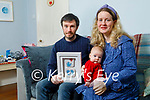 Danny and baby Fallon Riordan and Maria Moynihan at home in Tralee as they hold a plaque of the foot and palm print of their son Danann who passed away from Edward Syndrome.