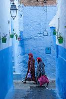 Chefchaouen, Morocco.  Women Walking in a Narrow Street.