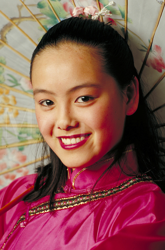 CHINESE AMERICAN TEEN IN TRADITIONAL COSTUME. CHINESE-AMERICAN TEEN GIRL. SAN FRANCISCO CALIFORNIA USA.
