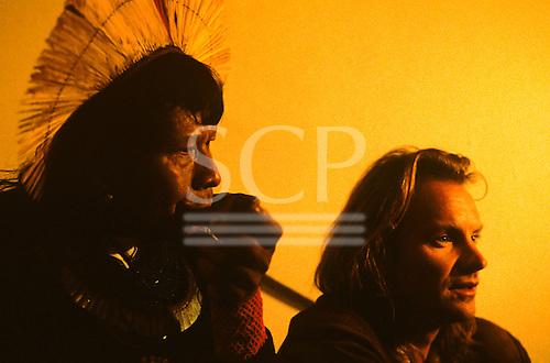 London, England. Brazilian Kayapo Indian chief Raoni Txukaramae and Sting at the launch of the Rainforest Foundation, 1989.