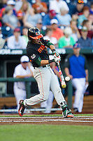 Miami Hurricanes shortstop Brandon Lopez (51) swings the bat against the Florida Gators in the NCAA College World Series on June 13, 2015 at TD Ameritrade Park in Omaha, Nebraska. Florida defeated Miami 15-3. (Andrew Woolley/Four Seam Images)