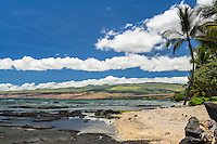 A sunny morning with blue skies and rolling hills as seen in Puako, Big Island of Hawai'i.