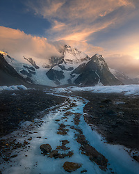 A stream of snow melt formed a nice S-curve, and as the sun set the clouds parted to reveal the mountain.