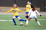 BROOKINGS, SD - MARCH 14: Katherine Jones #17 from South Dakota State pushes the ball against Malak Rafik #7 from Denver during their match at Dana J. Dykhouse Stadium on March 14, 2021 in Brookings, South Dakota. (Photo by Dave Eggen/Inertia)