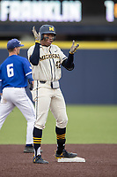 Michigan Wolverines outfielder Jordan Nwogu (42) celebrates after hitting a double against the Indiana State Sycamores on April 10, 2019 in the NCAA baseball game at Ray Fisher Stadium in Ann Arbor, Michigan. Michigan defeated Indiana State 6-4. (Andrew Woolley/Four Seam Images)