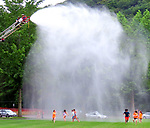 BEACON FALLS, CT. - 19 July 2021-071921SV03-Kids from the United Day School summer program get sprayed by firefighters from Beacon Hose Co. No. 1 during a water day at the Pent Road Recreation Center in Beacon Falls Monday.<br /> Steven Valenti Republican-American