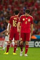 Javi Martinez of Spain looks dejected