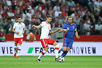 8th September 2021; PGE National Stadium, Warsaw, Poland: FIFA World Cup 2022 Football qualification, Poland versus England;  JAN BEDNAREK challenges HARRY KANE