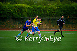 Jamie McIntyre of Classic races ahead and clears his defence as Dean McAullife of Dingle Bay Rovers gives chase, in the Denny KDL Challenge Cup