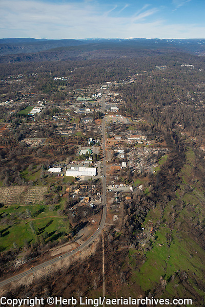 aerial photograph of the aftermath of the  2018 Camp Fire, Paradise, Butte County, California. Clark Road, highway 191, is in the center of the photograph.