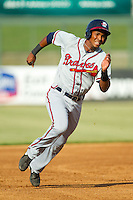 Carlos Franco (11) of the Rome Braves hustles towards third base against the Kannapolis Intimidators at CMC-Northeast Stadium on August 25, 2013 in Kannapolis, North Carolina.  The Intimidators defeated the Braves 9-0.  (Brian Westerholt/Four Seam Images)