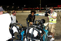 Photo: Richard Lane/Richard Lane Photography. London Wasps in Abu Dhabi for their LV= Cup game against Harlequins on 30st January 2011. 28/01/2011. Richard Haughton checks on Marty Veale and Nic Berry in a drag racing car at a raceway in Abu Dhabi.