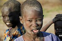 SOUTH SUDAN Bahr al Ghazal region , Lakes State, village Yeri cattle camp near Rumbek, Dinka boy Laat 10 years old, for the initialization the lower front teeth are removed / SUED-SUDAN  Bahr el Ghazal region , Lakes State, Dorf Yeri, Dinka mit Zebu Rindern im cattle camp bei Rumbek ,  Junge Laat 10 Jahre Bruder von Mathou, waehrend der Initialisierungszeremonie werden den Jungen die vorderen unteren Schneidezaehne heraus gebrochen