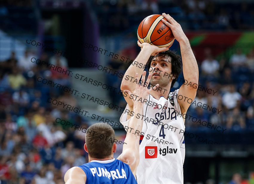 BELGRADE, SERBIA - JULY 08: Milos Teodosic (R) of Serbia in action against Pavel Pumprla (L) of Czech Republic during the 2016 FIBA World Olympic Qualifying basketball Semi Final match between Serbia and Czech Republic at Kombank Arena on July 08, 2016 in Belgrade, Serbia. (Photo by Srdjan Stevanovic/Getty Images)