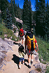 A family of three hiking along the trail to Dream Lake in Rocky Mtn Nat'l Park, CO