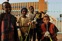NIGER Niamey, soccer stadium PALAIS DU 29 JUILLET, children with self-made plastic tin shed toy cars