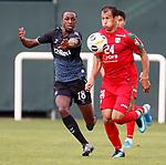 11.01.2020 Rangers v Lokomotiv Tashkent, Sevens Stadium, Dubai:<br /> Glen Kamara and Davron Khoshimov