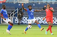KANSAS CITY, KS - JULY 15: Stephane Lambese #5 of Haiti ,Cyle Larin #17 of Canada during a game between Canada and Haiti at Children's Mercy Park on July 15, 2021 in Kansas City, Kansas.
