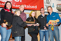 The GCI Dorothy G. Page Halfway Award is presented by Jenifer Nelson, senior manager, consumer marketing for GCI and others to Mitch Seavey at the Nome Musher's Award Banquet during the 2017 Iditarod on Sunday March 19, 2017.<br /> <br /> Photo by Jeff Schultz/SchultzPhoto.com  (C) 2017  ALL RIGHTS RESERVED