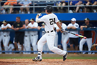 Gavin Sheets (24) of the Wake Forest Demon Deacons follows through on his swing against the Florida Gators in the completion of Game Two of the Gainesville Super Regional of the 2017 College World Series at Alfred McKethan Stadium at Perry Field on June 12, 2017 in Gainesville, Florida. The Demon Deacons walked off the Gators 8-6 in 11 innings. (Brian Westerholt/Four Seam Images)