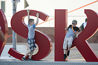 SARANSK, RUSSIA - June 25, 2018: Two boys play on a structure spelling 'Saransk' at Millennium Square in Saransk before the 2018 FIFA World Cup group stage match between Iran and Portugal at Mordovia Arena.