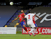 PASTO-COLOMBIA, 28-02-2021: Jeison Medina de Deportivo Pasto y Marlon Torres de America de Cali disputan el balon, durante partido de la fecha 10 entre Deportivo Pasto y America de Cali por la Liga BetPlay DIMAYOR I 2021 jugado en el estadio Departamental Libertad de la ciudad de Pasto. / Jeison Medina of Deportivo Pasto and Marlon Torres of America de Cali figth for the ball, during a match of the 10th date between Deportivo Pasto and America de Cali for the BetPlay DIMAYOR I 2021 League played at the Departamental Libertad Stadium in Pasto city. / Photo: VizzorImage / Leonardo Castro / Cont.