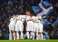 Swansea City team huddle during the Barclays Premier League match between Manchester City and Swansea City played at the Etihad Stadium, Manchester on December 12th 2015