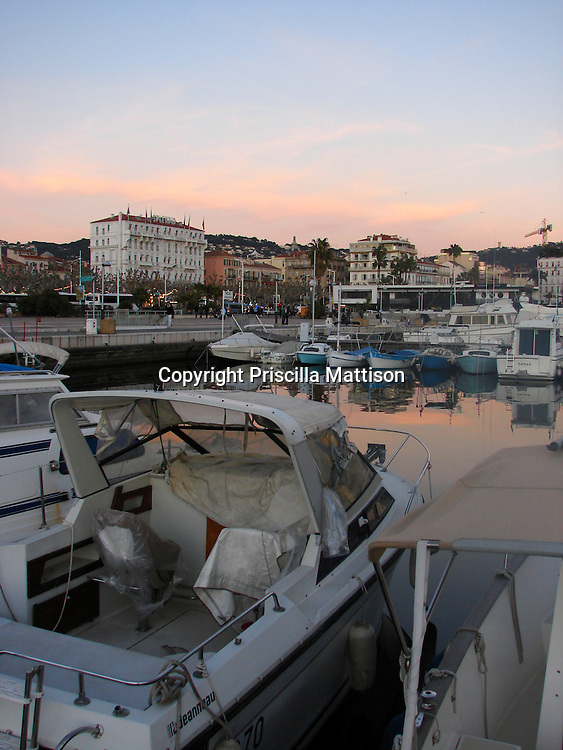 Cannes, France - January 26, 2008:  The harbor glows in the sunset.