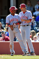 Hagerstown Suns shortstop Wilmer Difo (6) talks with first base coach John Wooten (22) during a game against the Lexington Legends on May 19, 2014 at Whitaker Bank Ballpark in Lexington, Kentucky.  Lexington defeated Hagerstown 10-8.  (Mike Janes/Four Seam Images)