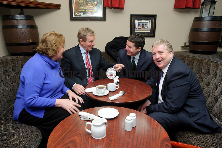 Enda Kenny, Taoiseach chatting with Madeleine Taylor Quinn, former Fine Gael TD, Tourism Minister Paschal Donohoe,TD and Pat Breen, TD in Carmody's bar, Carrigaholt following  to Loop Head to launch the Fine Gael tourism initiative. Photograph by John Kelly.
